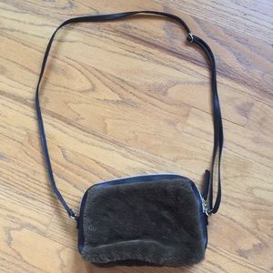 Green and black fuzzy purse